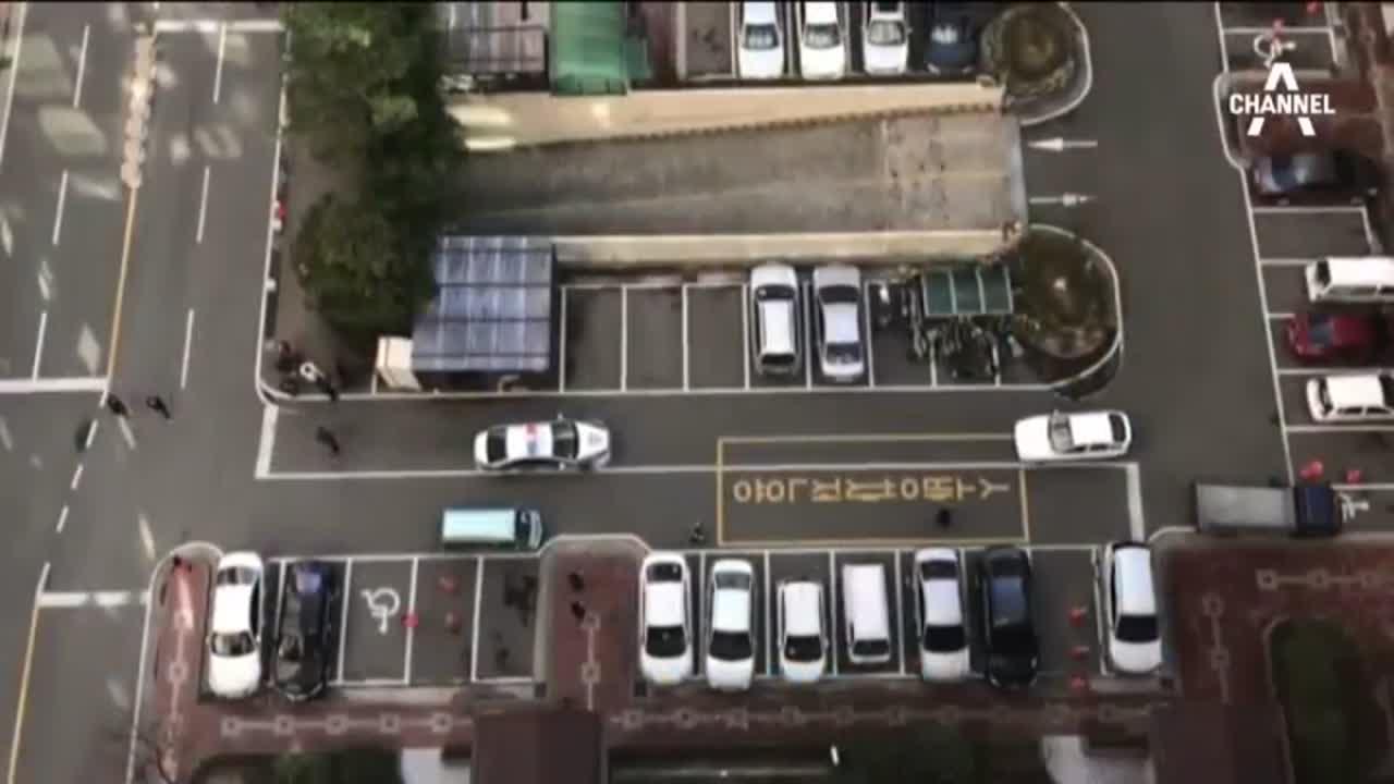 대낮 아파트 단지 광란 운전…공포탄 검거