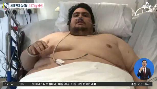 [세상터치]크레인에 실려간 317kg 남성 / '영부인....